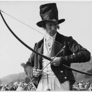 409 - Man in costume with bow
