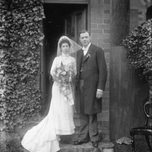 G36-031-09 Bride and groom at front door.jpg