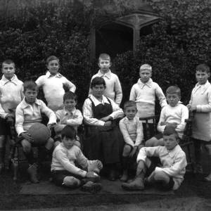 G36-388-01 Hereford Cathedral  Prep School football team with Miss Gamlen .jpg