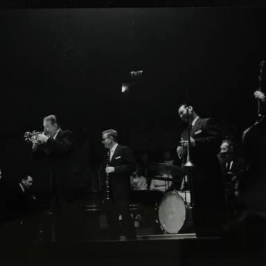 Eddie Condon, Gene Schroeder, Bob Wilber, Wild Bill Davison, Robert 'Cutty' Cutshall, George Wettling and Leonard Gaskin (left to right)