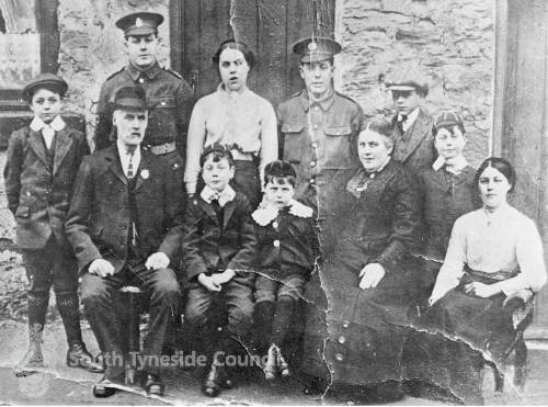 Family Group with soldier sons