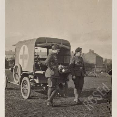 Captain Verel and Corporal Anderson beside Ford Light Car Ambulance