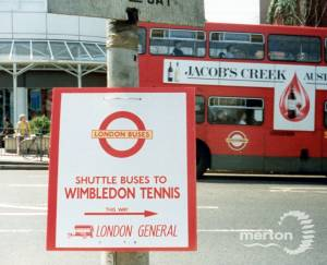 Sign promoting the All England Lawn Tennis Shuttle Bus, Wimbledon