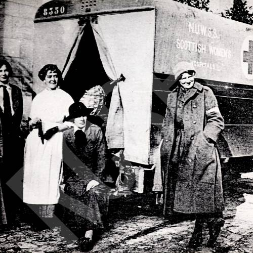 Frances Ivens, Cecily Hamilton and others at Royaumont Hospital door, N.U.W.S.S. vehicle in background