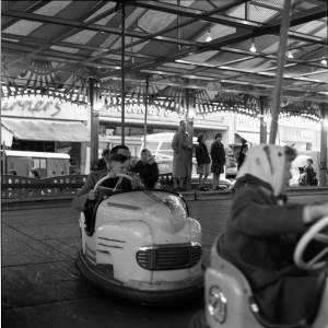 A Little Boy Steers a Dodgem Cart at the 1962 Hereford May Fair