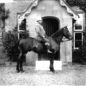 G36-326-13 Gentleman seated on horse in front of porch - Copy.jpg