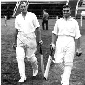 Two batsmen playing cricket at Hereford.
