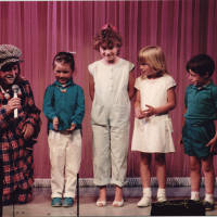 Photograph - unknown performer with children on stage