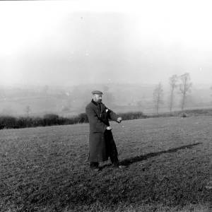 G36-179-01 Man holding divining rods in field.jpg