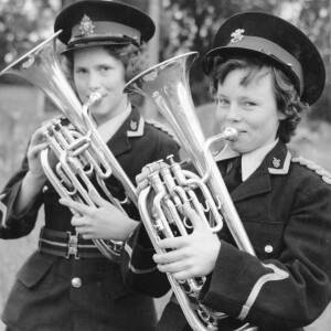 Marjorie Kear and Jennifer Watts playing tenor horn on the Heart of Oak Friendly Society Club walk.