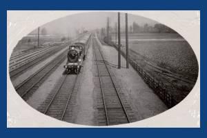 Train on the rail line near Durnsford Road bridge, Wimbledon
