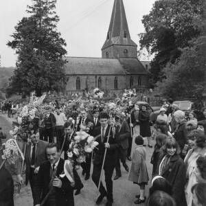 031 - Men carrying floral poles from Fownhope Church