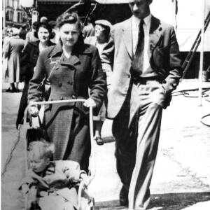 A couple walking with a small child.