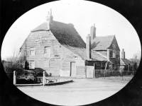 Rats Castle:  A weatherboarded cottage in Phipps Bridge