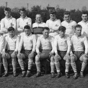 A rugby team with officials.