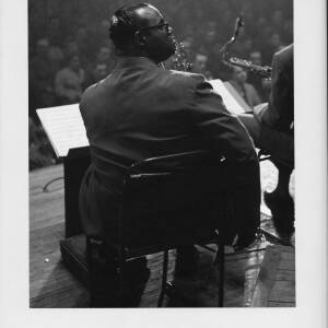 473 - Black musician looking over his shoulder at concert.
