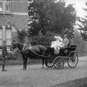 G36-029-08 Family seen in G36-029-01 - pony and governess cart, boy standing.jpg