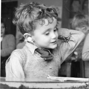 A young boy in class at Wessington Court School for the Deaf at Woolhope, 1960s.