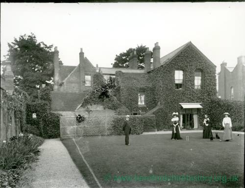 G36-216-12 Croquet on lawn in front of ivy-covered house 3 ladies, older man & 2 dogs.jpg