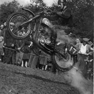 A motorbike scrambler competing in a event.