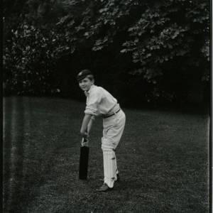 G36-022-10 Boy in cricket whites with bat.jpg