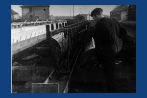 Carpenter working on a bridge beam, Windsor Avenue