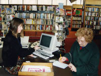 Customer reserving a book at Mitcham Library