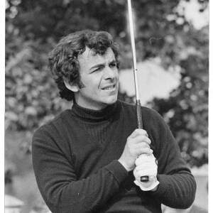 235 - Tony Jacklin holding golf club in the air and looking in the distance