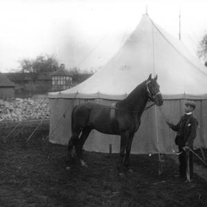 G36-223-06 Man with horse.  Dovecote at Byford (?) in background.jpg
