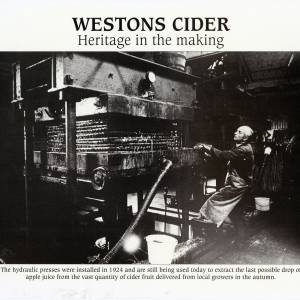 Westons cider - using a hydraulic press to extract apple juice - press installed in 1924