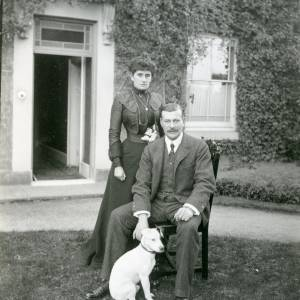 G36-025-06 Man and woman with dog outside house.jpg