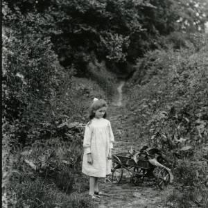G36-007-04 Girl standing by small cart.jpg