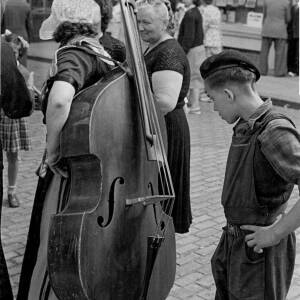 "148 - Woman carrying double bass ""Some fiddle"""