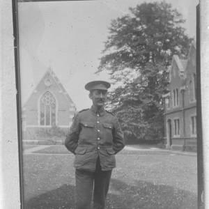 Soldier stood in courtyard