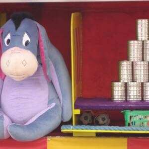 Stack of cans and Eeyore toy