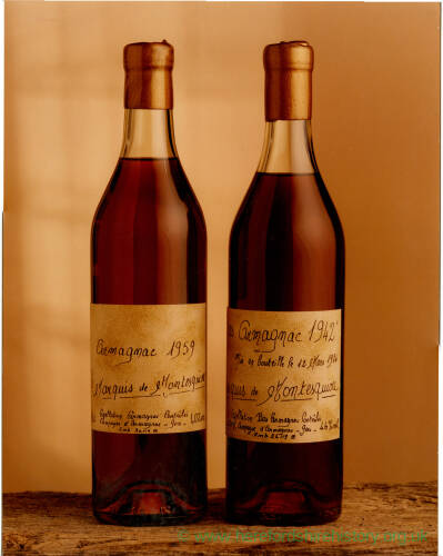 241 - Two champagne bottles; labels written in French