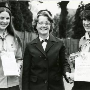 RG1882 Two members of Ross Guides receiving certificate and badges, 14th July 1983.jpg