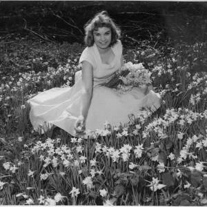 625 - Young Jane Hancocks holding bunch of daffofils in field of daffodils