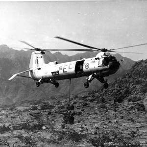 A Belvedere helicopter of 26 Squadron delivering water.