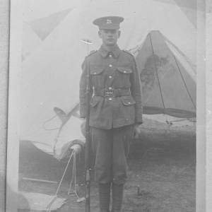 Soldier outside tent