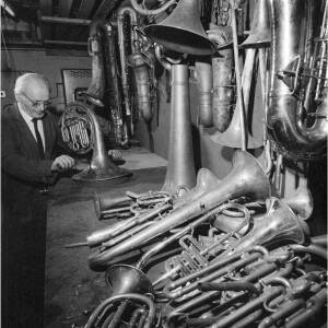 128 - Older man making French horn