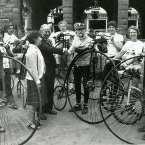 RG1890 Group of people on Penny Farthing bicycles outside Market House, Ross-on-Wye, 21st July 1983.jpg