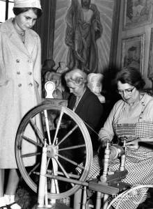 Mrs Louise Littleton working her spinning wheel