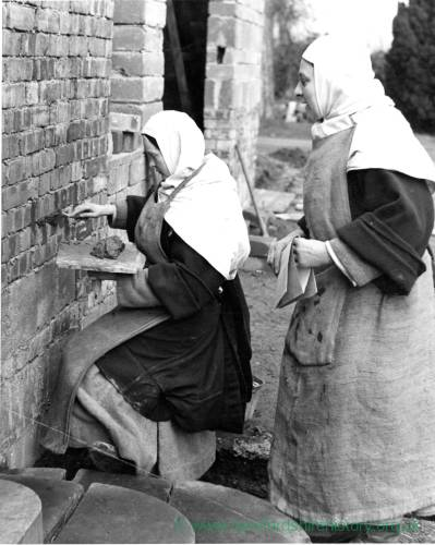Sisters from the Carmelite Order of Presteign repoint brick wall