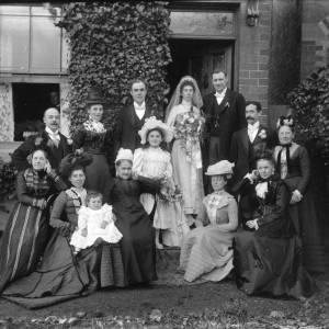 G36-031-14 Wedding group at front door.jpg