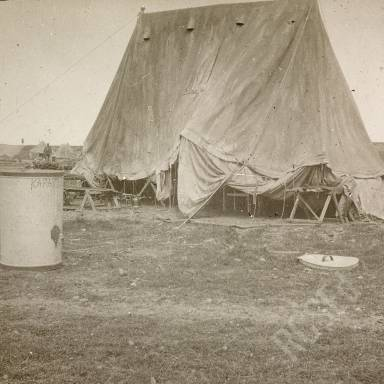 "Tent at Camp with Container Marked ""Karasouli"""