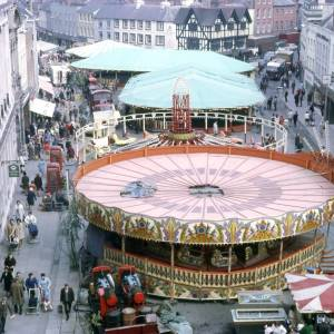 Rides at the May Fair, looking towards the Old House, High Street, Hereford, 1970