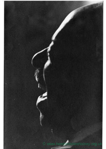 250 - Silhouetted side view of black man singing