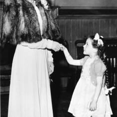 A young girl being presented to the 'Coronation Queen' 1951