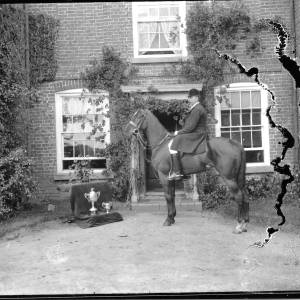 G36-419-18 Horseman outside house with two cups.jpg